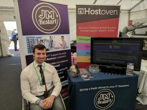 Managing Director Matthew Baker with JM Restart's stand at the Anglia Business Exhibition 2017
